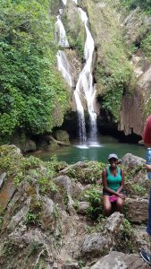 Sophomore Alisa Mobley enjoys the cool mist of a waterfall in the Escambray Mountains.