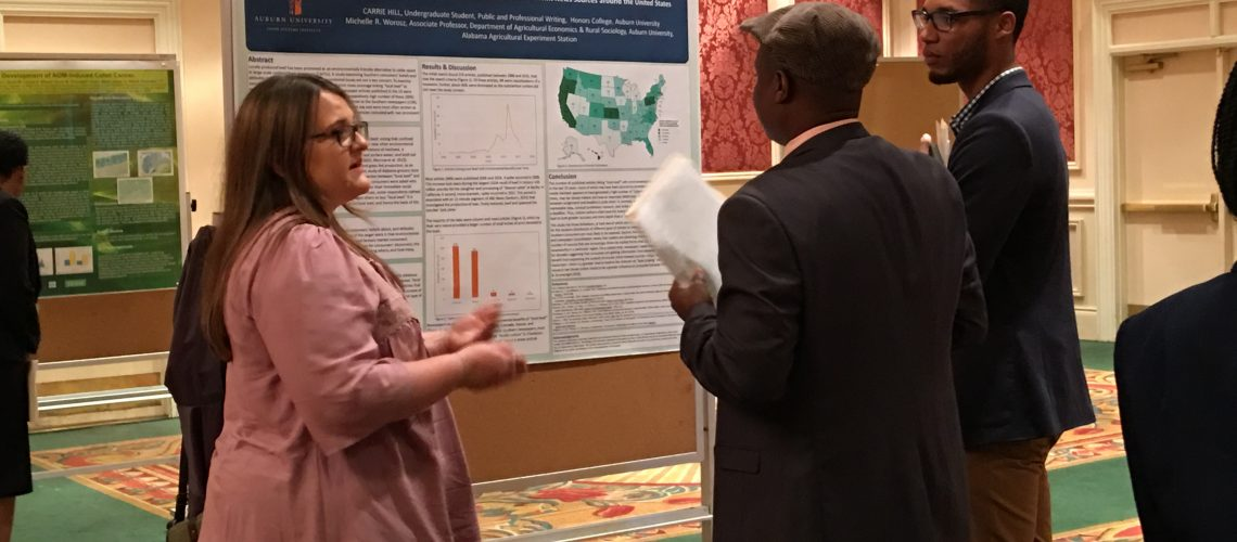 Carrie Hill discussing her poster