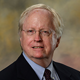 headshot of Honors College Director Emeritus Professor Gwin