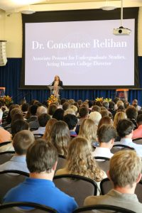 Dr. Relihan speaking at freshmen induction ceremony
