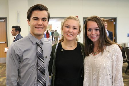three honors students at the freshmen induction ceremony