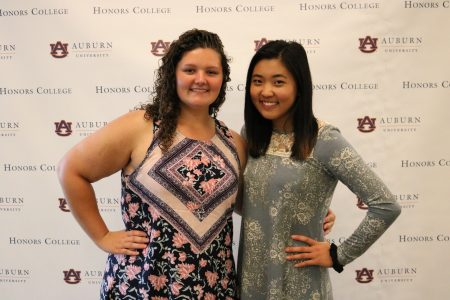 two new honors students in front of step and repeat