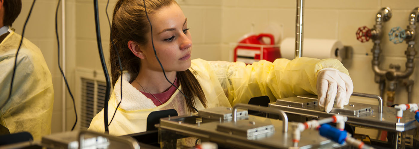 top image girl in lab doing undergraduate research