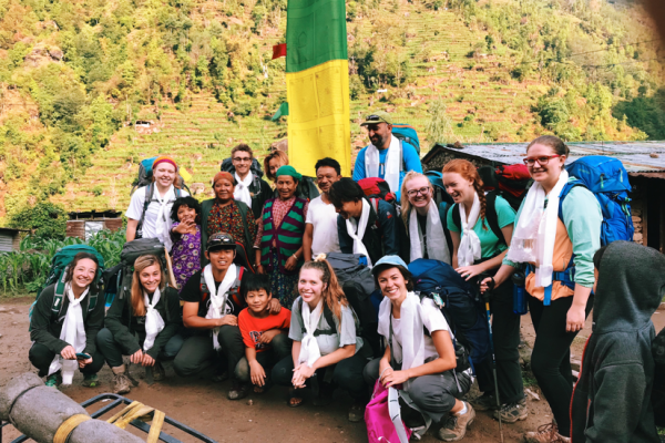 Lindsey with group of interns and locals in Nepal village