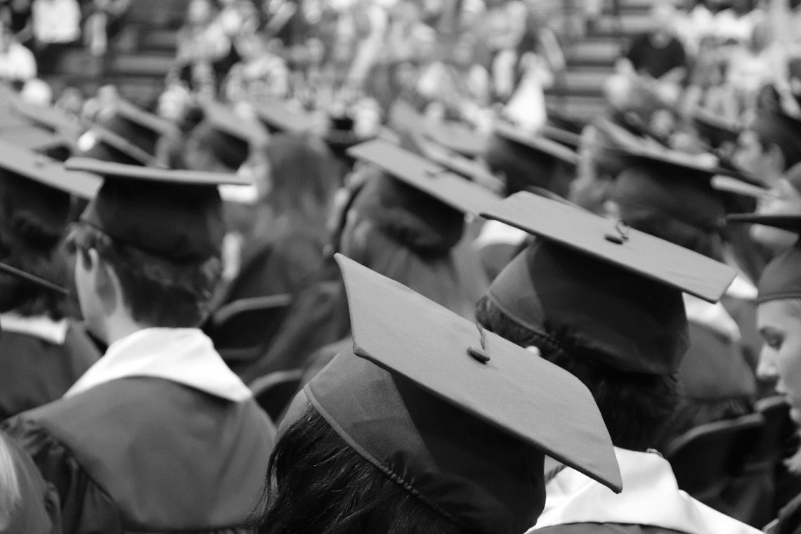 Black and white view of students' graduation caps